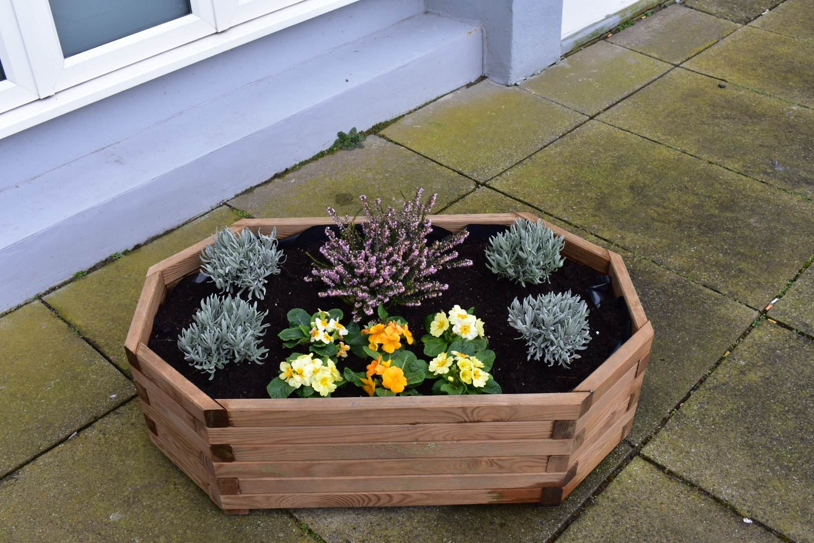 wooden planter with flowers