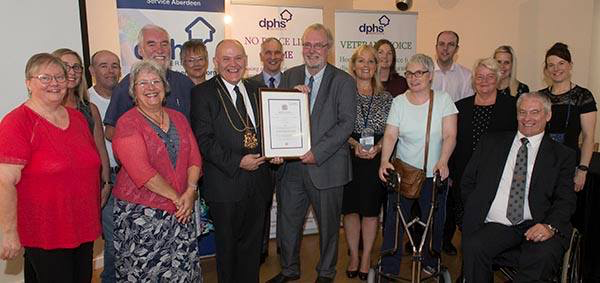 Group of DPHS people receiving the Queens Award