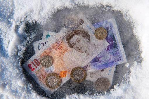 Money suspended in a block of ice